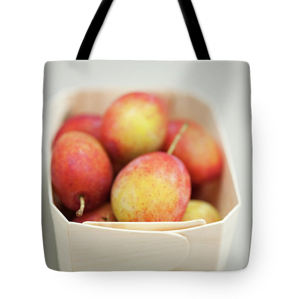 Plum Tote Bag featuring the photograph Punnet Of Victoria Plums by Diana Miller