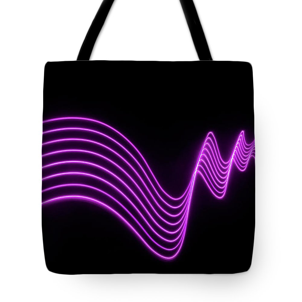 Laser Tote Bag featuring the photograph Purple Abstract Lights Trails And by John Rensten