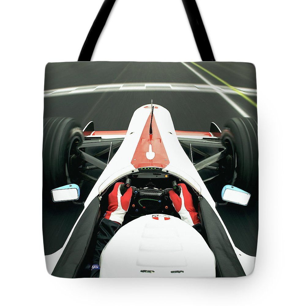 Aerodynamic Tote Bag featuring the photograph Racing Driver Approaching Finishing by Alan Thornton