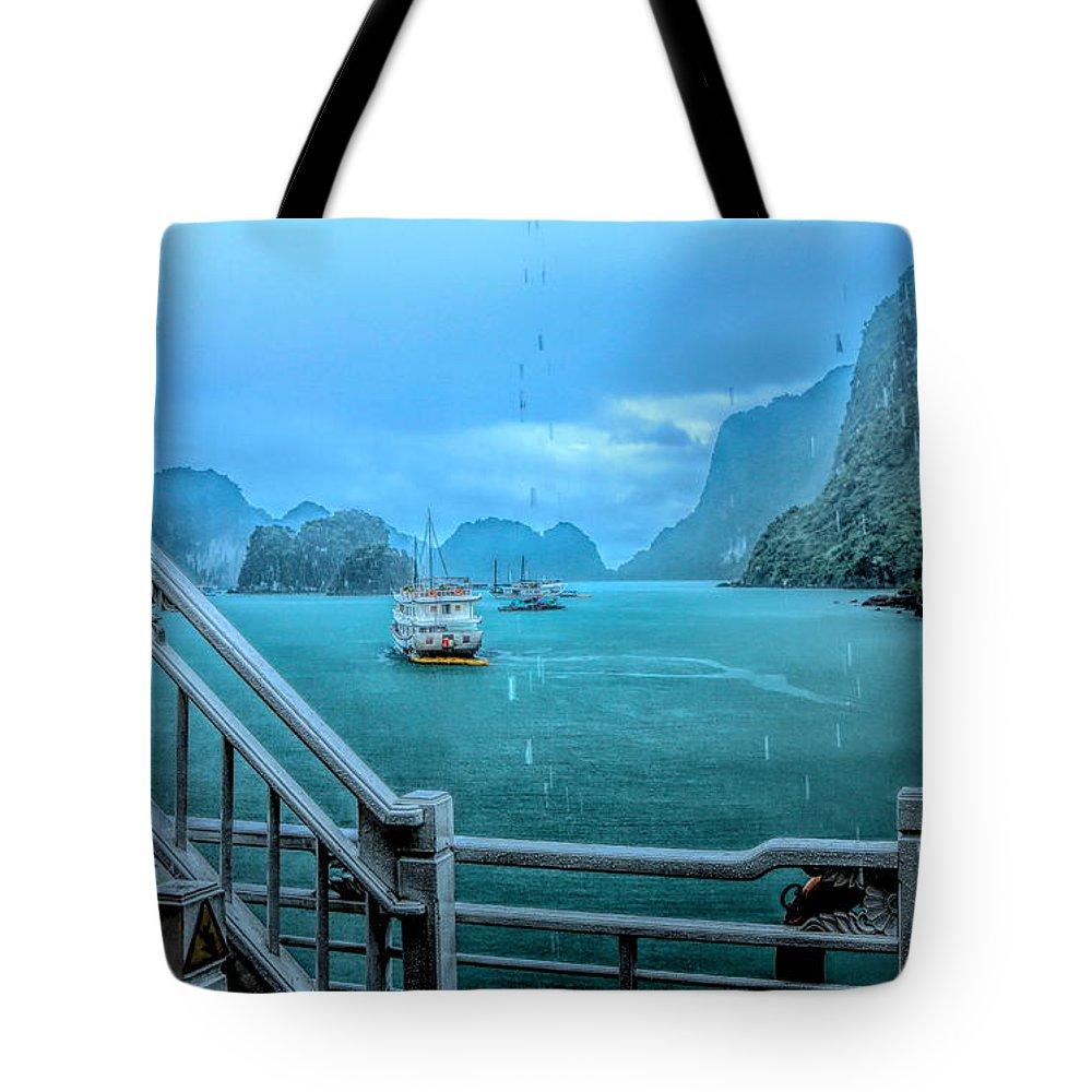 Vietnam Tote Bag featuring the photograph Rain Aboard Au Co Cruise Ha Long Bay by Chuck Kuhn