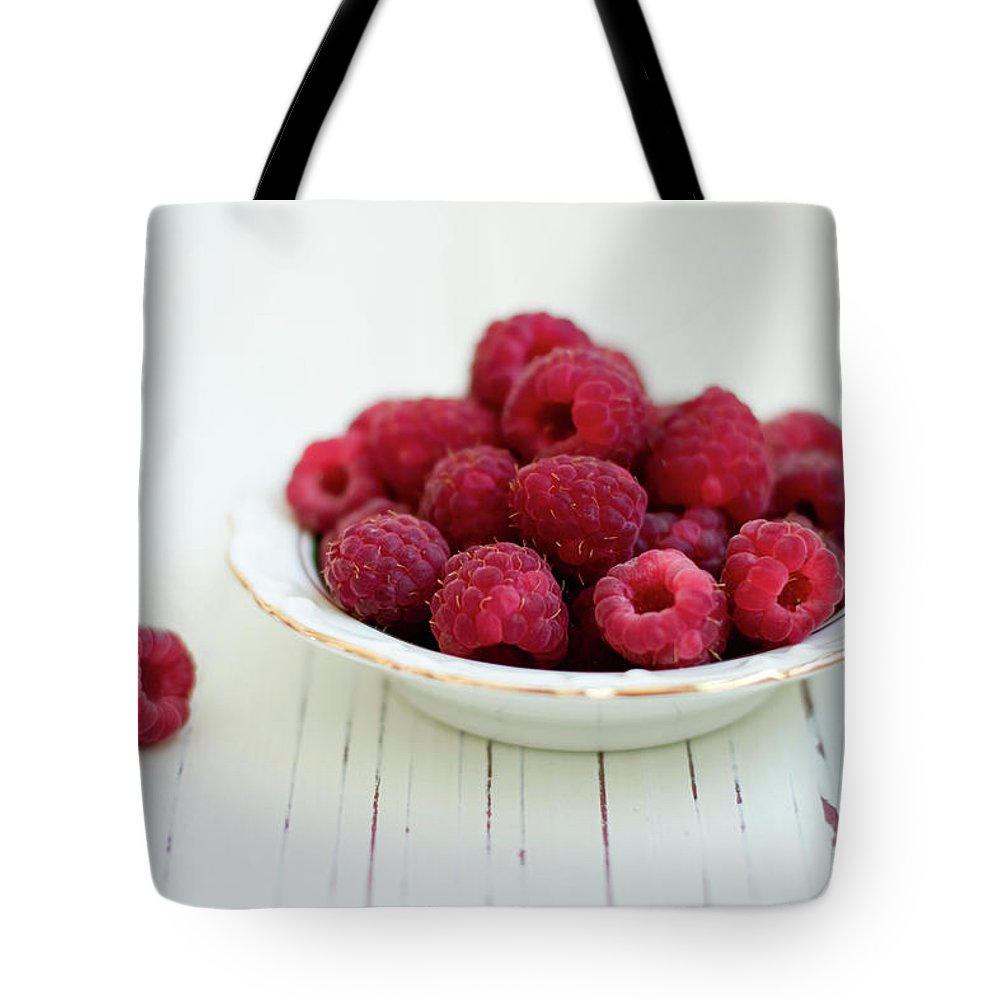 Outdoors Tote Bag featuring the photograph Raspberry In Vintage Plate On White by Copyright Anna Nemoy(xaomena)