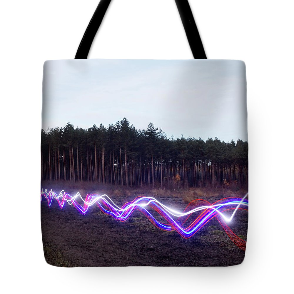 Internet Tote Bag featuring the photograph Red, Blue And White Light Trails On by Tim Robberts