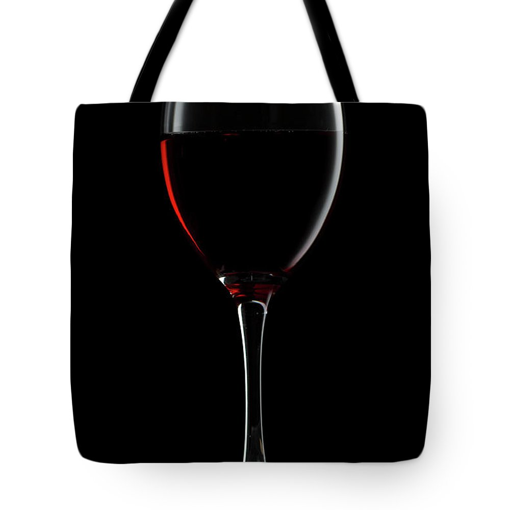 Alcohol Tote Bag featuring the photograph Red Wine by Julichka
