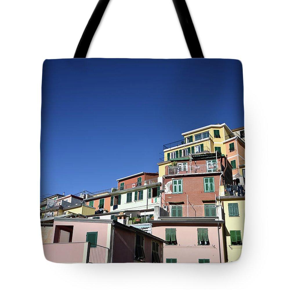 Empty Tote Bag featuring the photograph Riomaggiore by Eduleite
