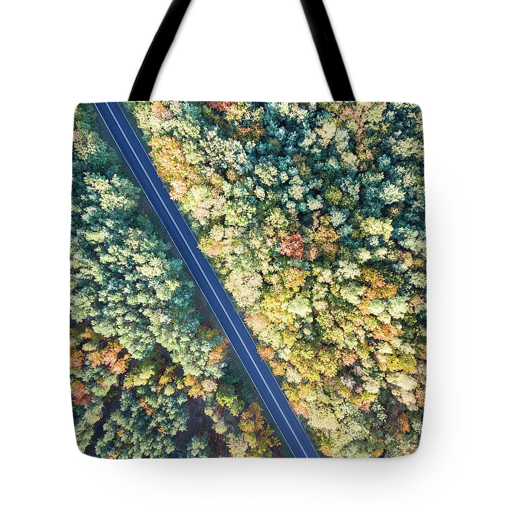 Aerial Tote Bag featuring the photograph Road Through Colorful Autumn Forest by Lukasz Szczepanski