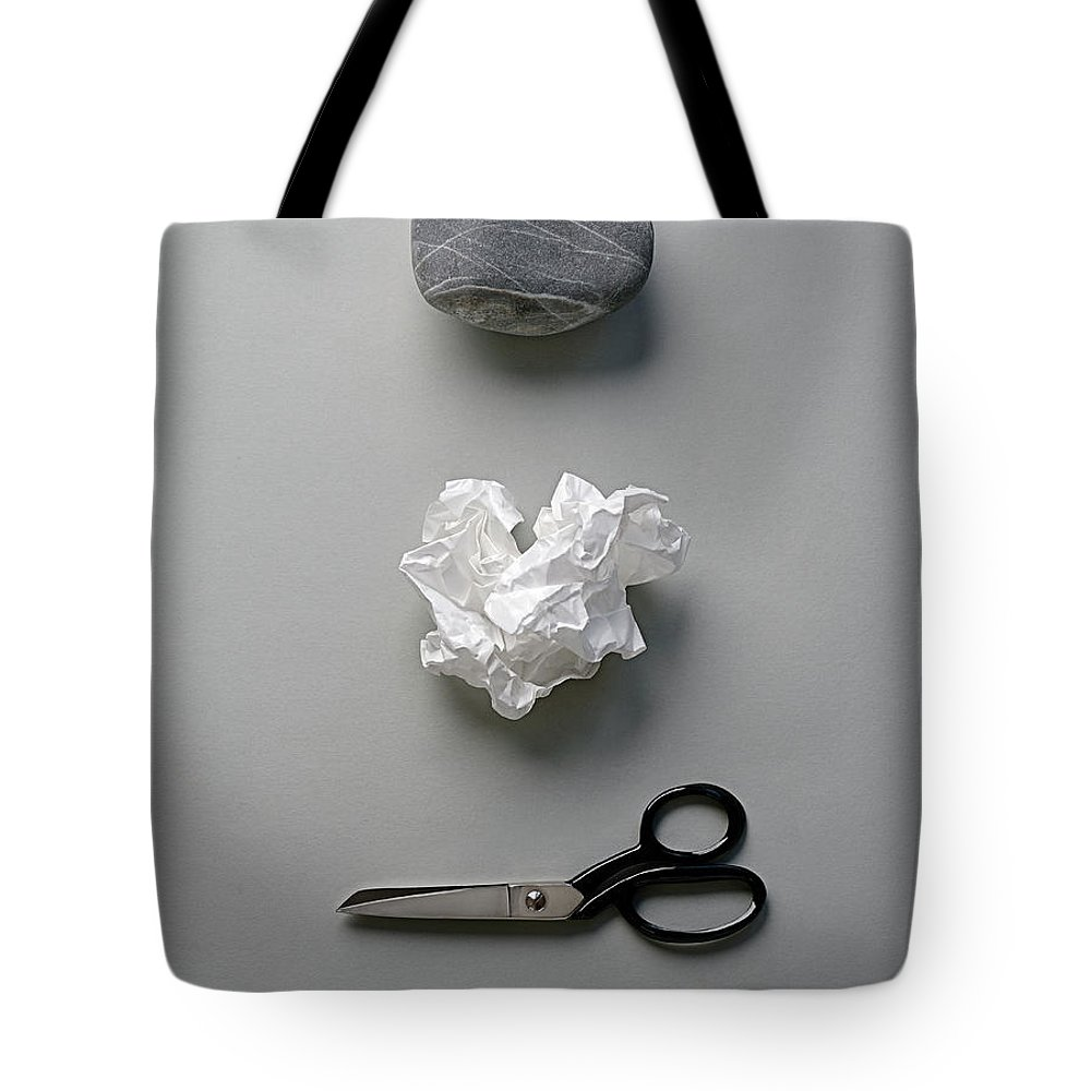 In A Row Tote Bag featuring the photograph Rock, Paper & Scissors by David Malan