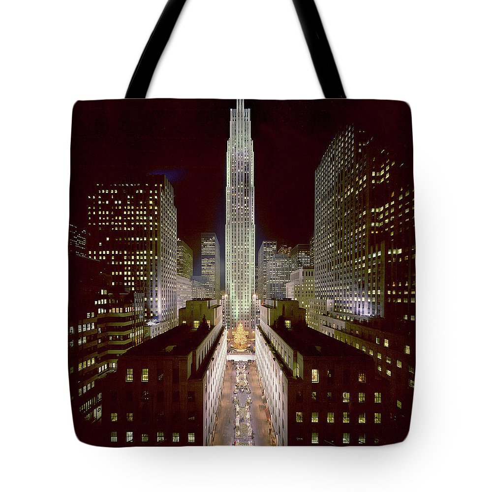 1980-1989 Tote Bag featuring the photograph Rockefeller Center, Manhatten, At by Thorney Lieberman