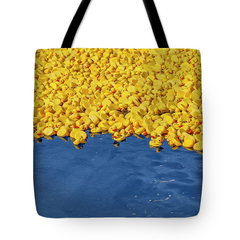 Rubber Ducks Tote Bag featuring the photograph Rubber Ducks by Trevor Slauenwhite