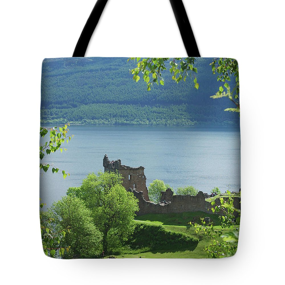 Castle Tote Bag featuring the photograph ruins of castle Urquhart on loch Ness by Victor Lord Denovan