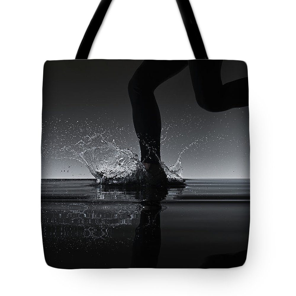 Recreational Pursuit Tote Bag featuring the photograph Running Through Water by Jonathan Knowles