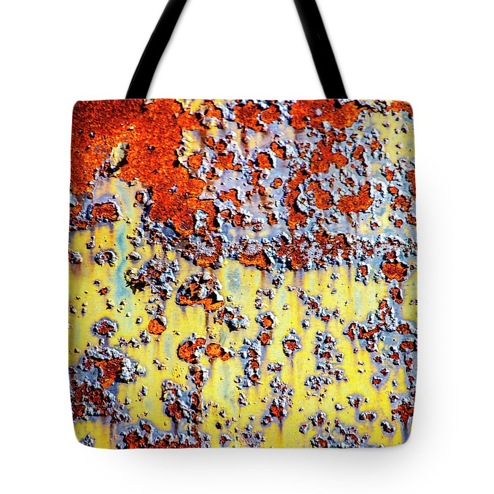Rust Tote Bag featuring the photograph Rust With Peeling Paint by Trevor Slauenwhite