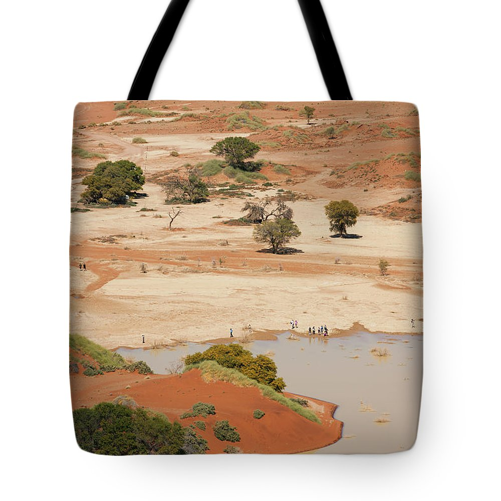 Namibia Tote Bag featuring the photograph Safari Tourists By Sossusvlei Pan by Bjarte Rettedal