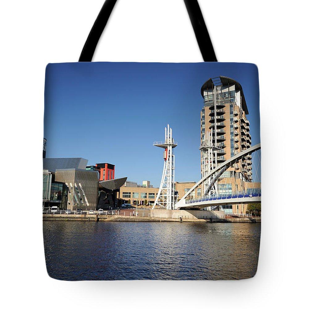 London Millennium Footbridge Tote Bag featuring the photograph Salford Quays, Manchester by Chrishepburn