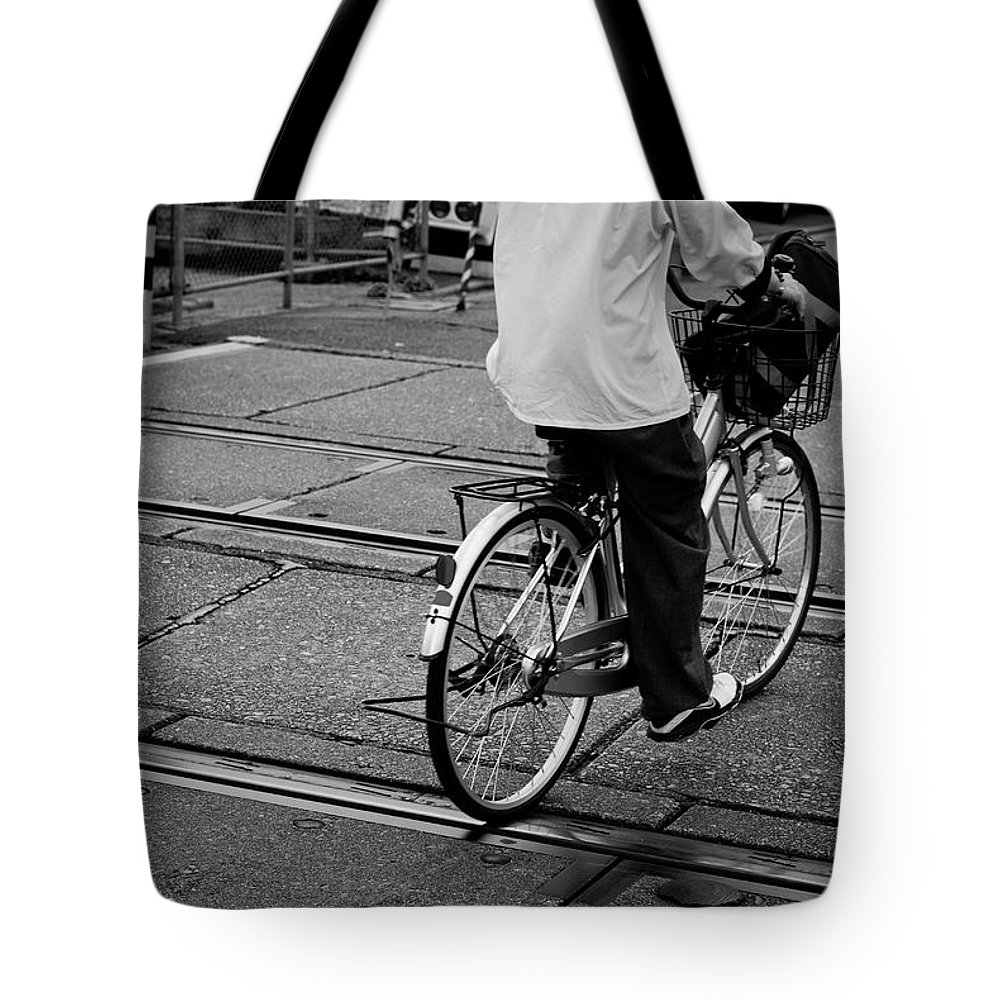 Child Tote Bag featuring the photograph Schoolboy Bicycling Across Railroad by Hedgy Nathan Wright