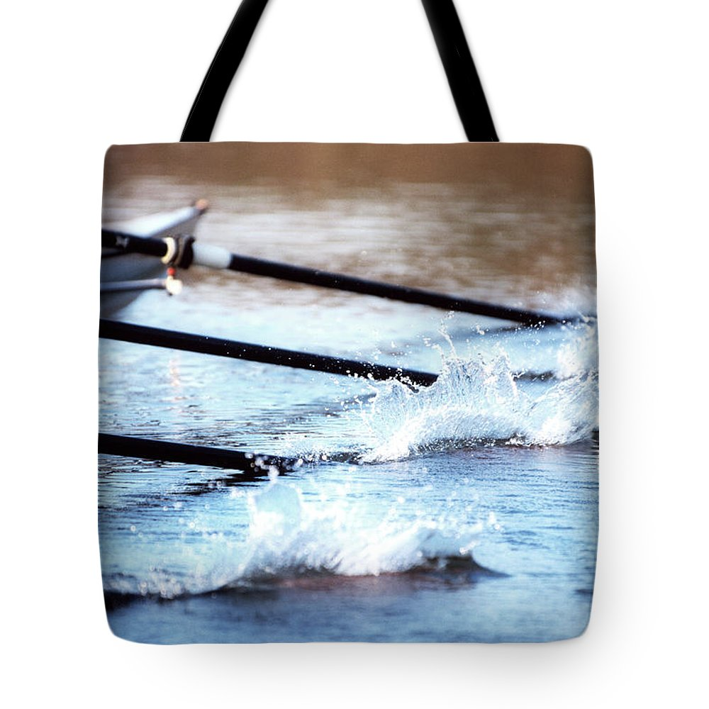 Sport Rowing Tote Bag featuring the photograph Sculling Team Rowing On Water by Robert Llewellyn