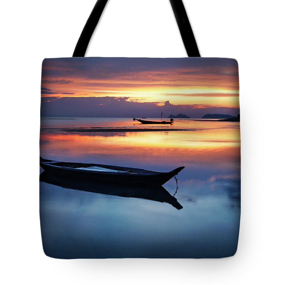 Scenics Tote Bag featuring the photograph Seashore With Longtail Boats At Sunset by Henrik Sorensen