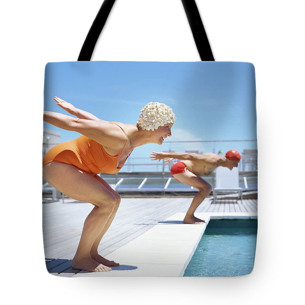 Diving Into Water Tote Bag featuring the photograph Senior Couple Ready To Dive In To by Stockbyte