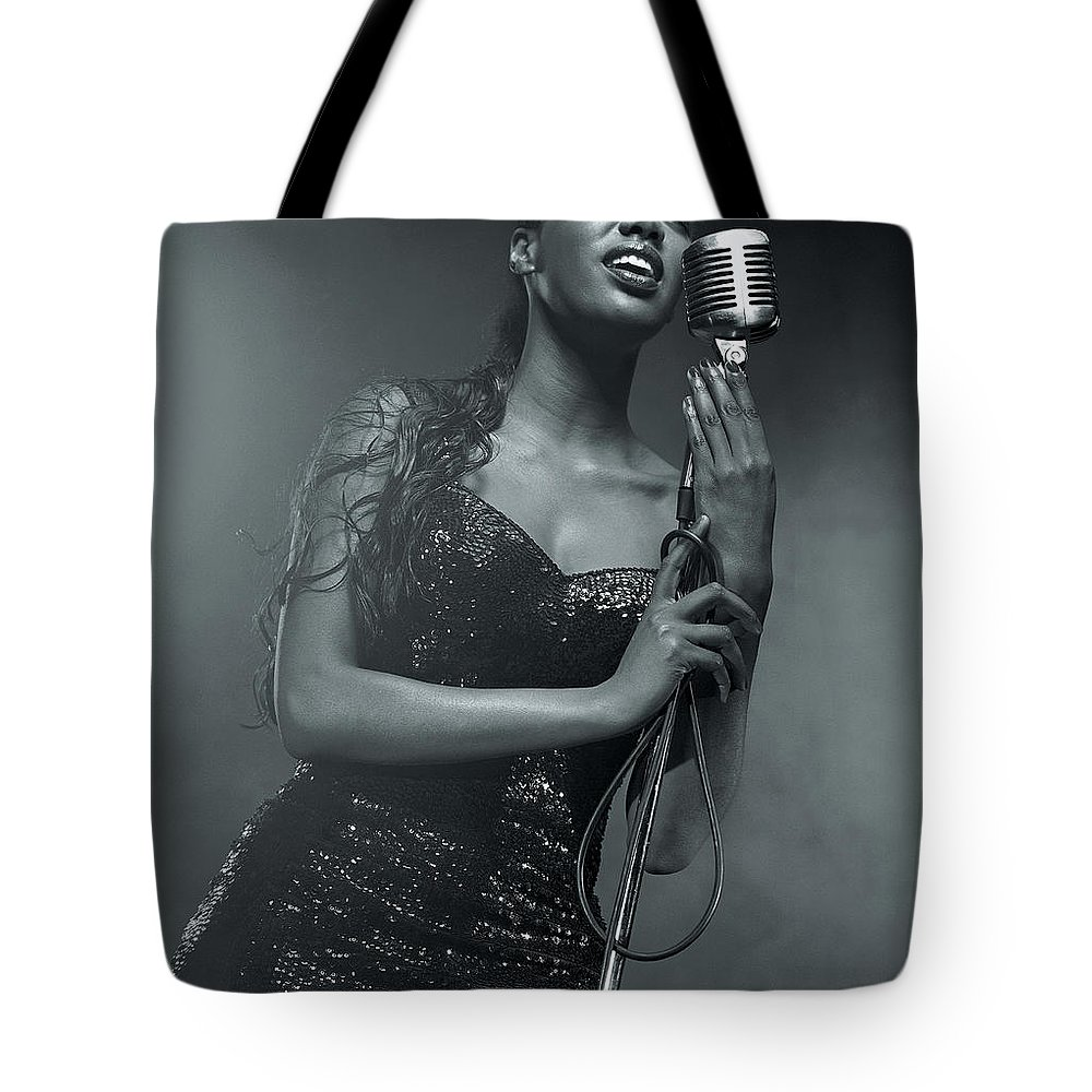 Singer Tote Bag featuring the photograph Sexy Singer With Microphone by Digital Vision.