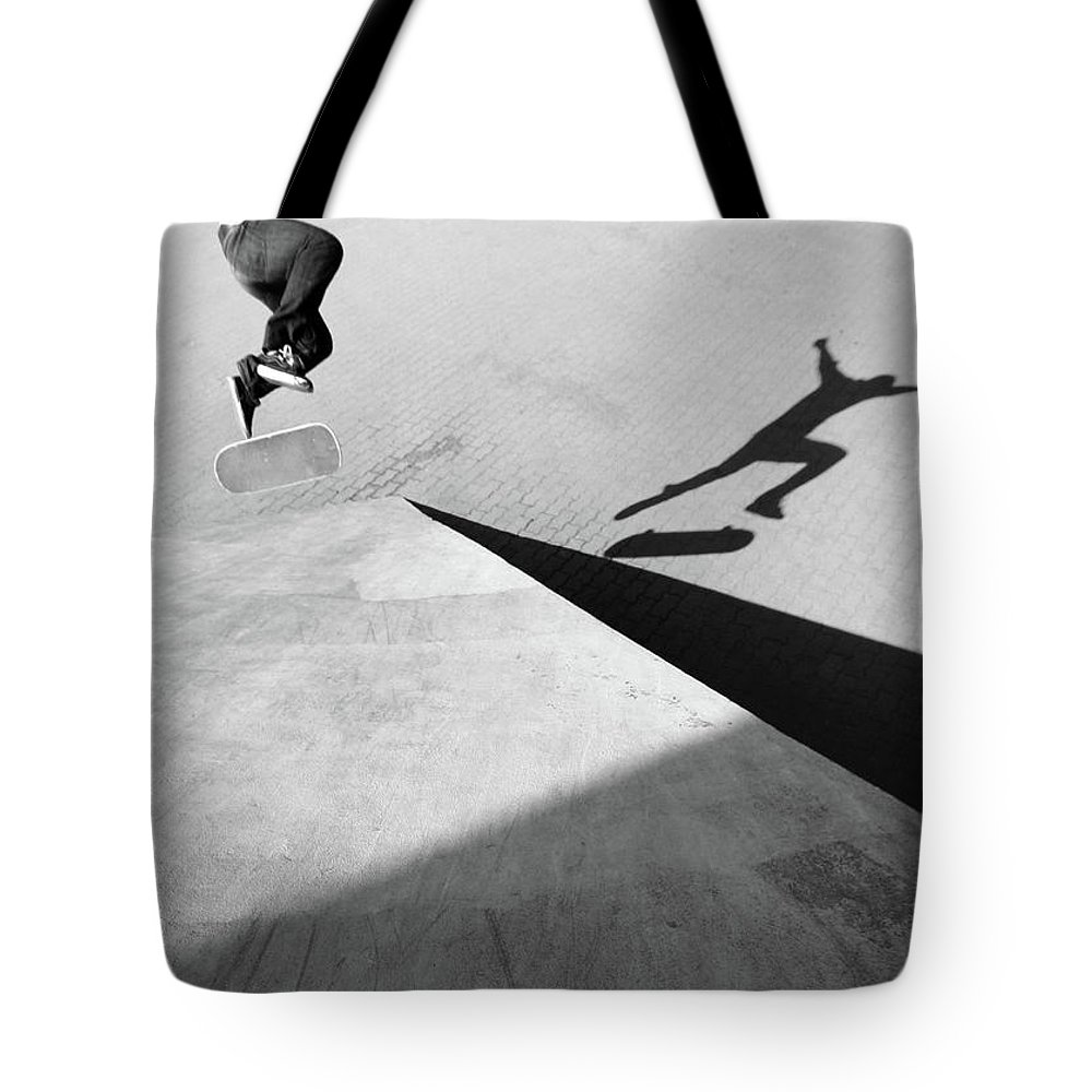 Shadow Tote Bag featuring the photograph Shadow Of Skateboarder by Mgs