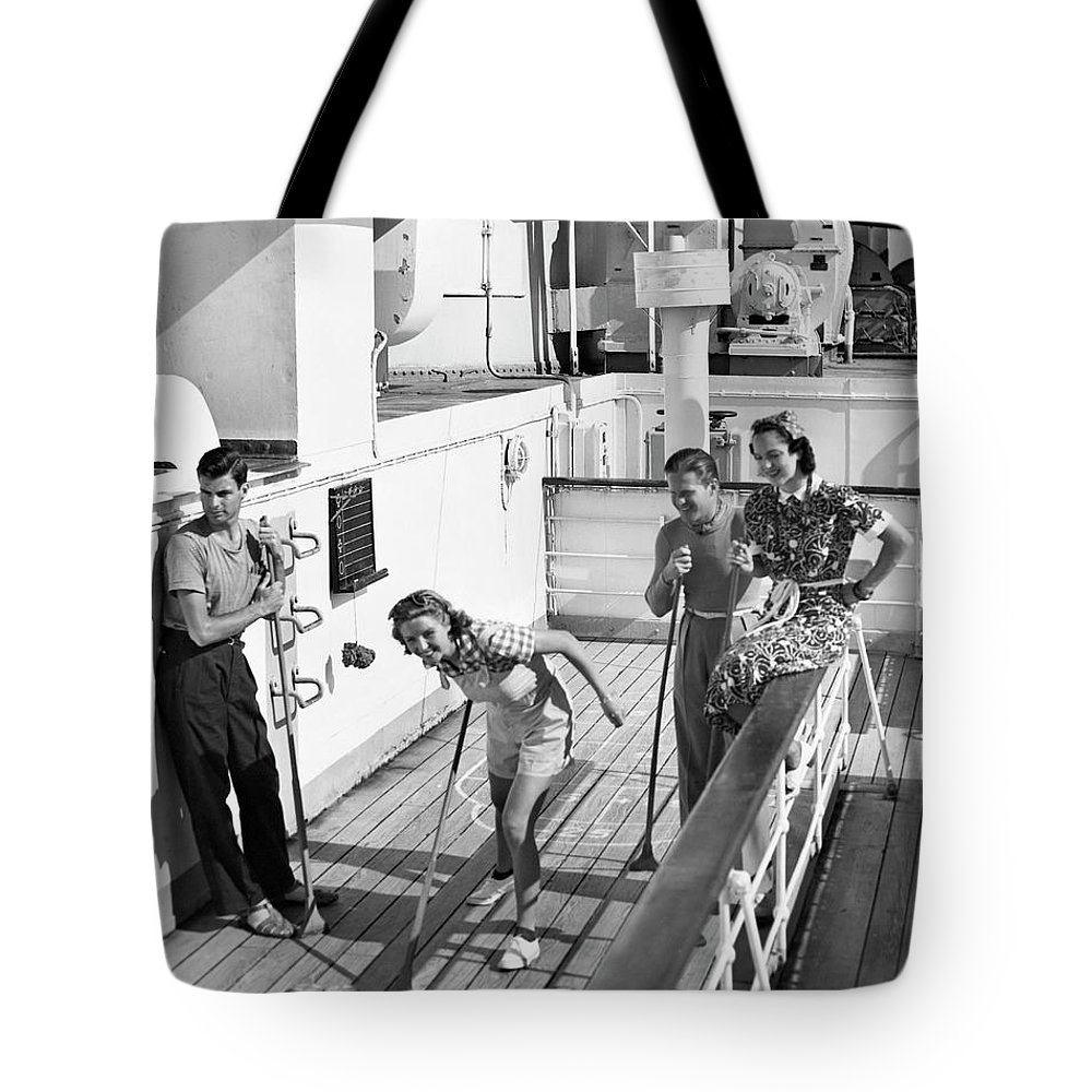 Heterosexual Couple Tote Bag featuring the photograph Shuffleboard Players by George Marks