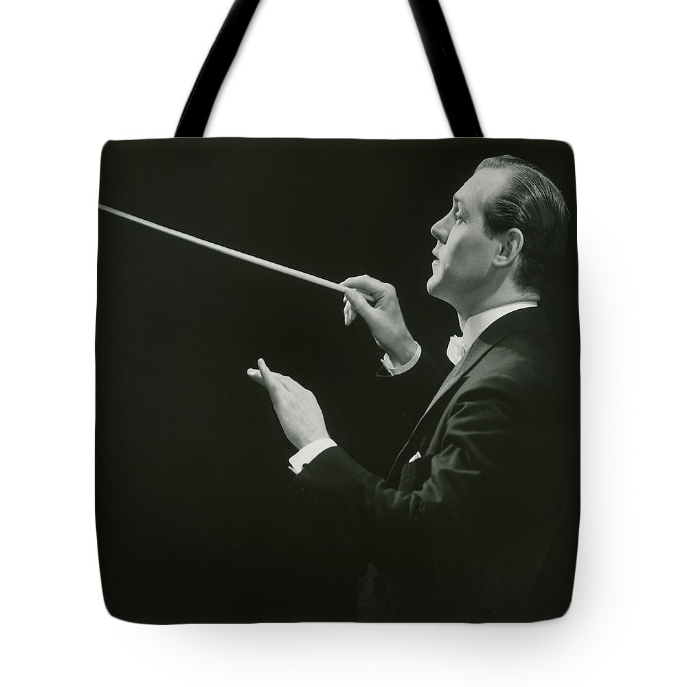 Musical Conductor Tote Bag featuring the photograph Side View Of Conductor by George Marks