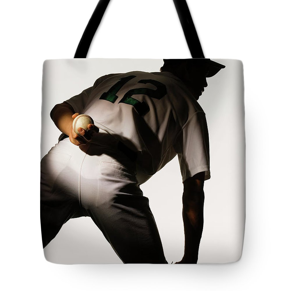 Three Quarter Length Tote Bag featuring the photograph Silhouette Of Baseball Pitcher Holding by Pm Images