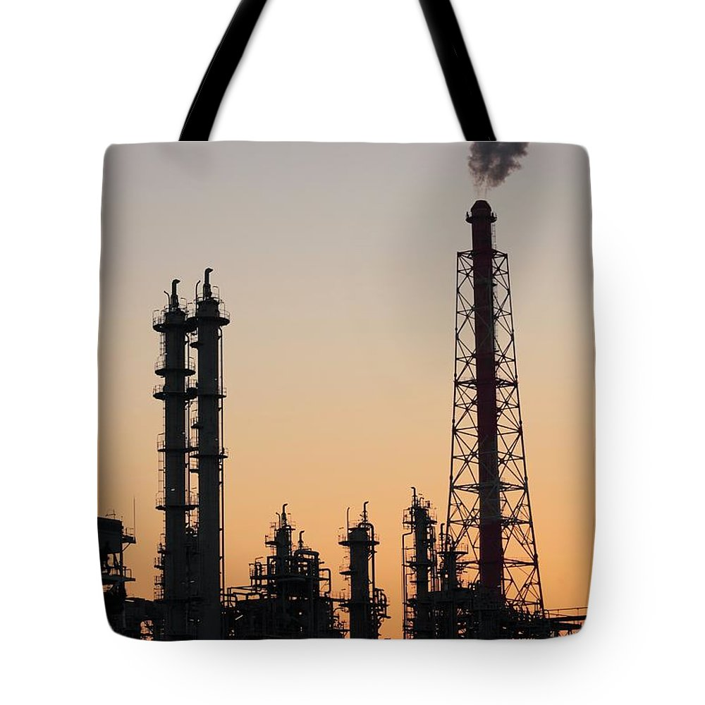Built Structure Tote Bag featuring the photograph Silhouette Of Petrochemical Plant by Hiro/amanaimagesrf