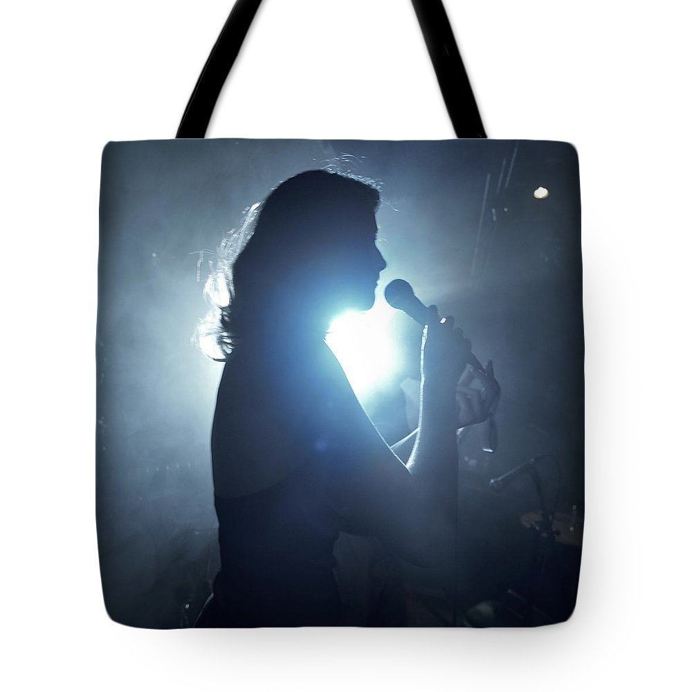 25-29 Years Tote Bag featuring the photograph Silhouette Of Woman Using Microphone by Frank Herholdt