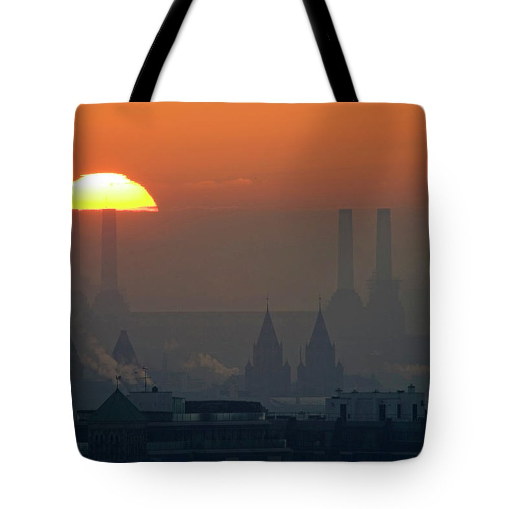 Tranquility Tote Bag featuring the photograph Silhouettes Of Chimneys And Spires by James Burns