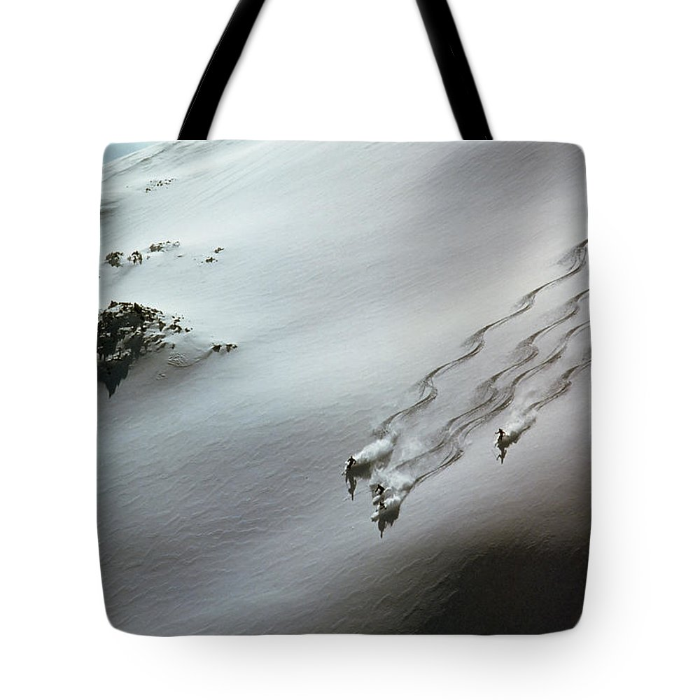 Shadow Tote Bag featuring the photograph Skier Moving Down In Snow On Slope by John P Kelly