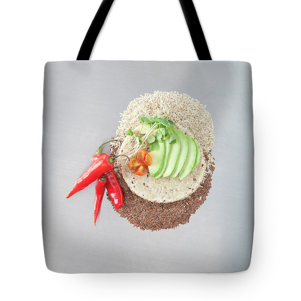 Flax Seed Tote Bag featuring the photograph Sliced Avocado And Peppers With Grains by Laurie Castelli