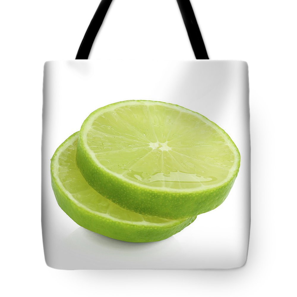 White Background Tote Bag featuring the photograph Slices Of Fresh, Juicy, Freshly Cut Lime by Rosemary Calvert