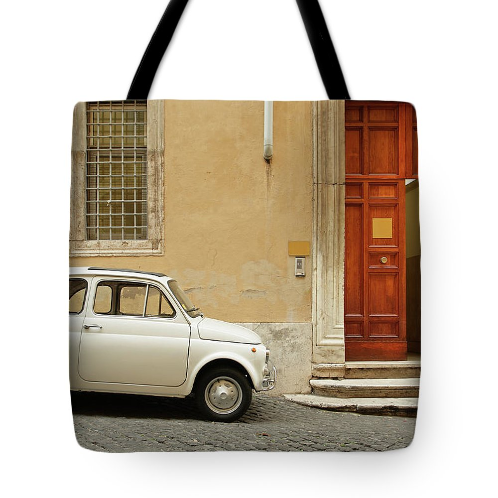 Steps Tote Bag featuring the photograph Small Coupe Parked Near A Doorway On A by S. Greg Panosian