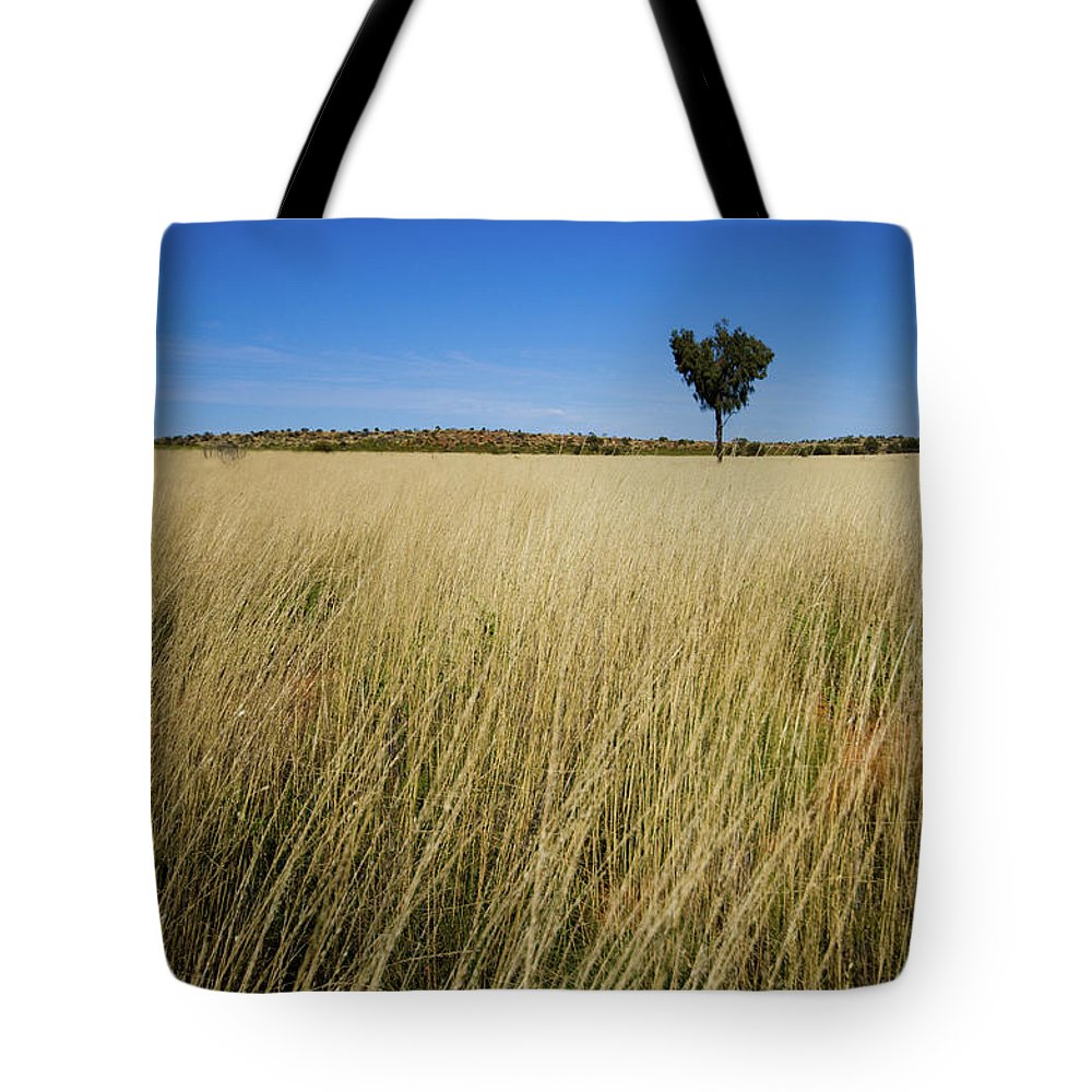 Scenics Tote Bag featuring the photograph Small Single Tree In Field by Universal Stopping Point Photography