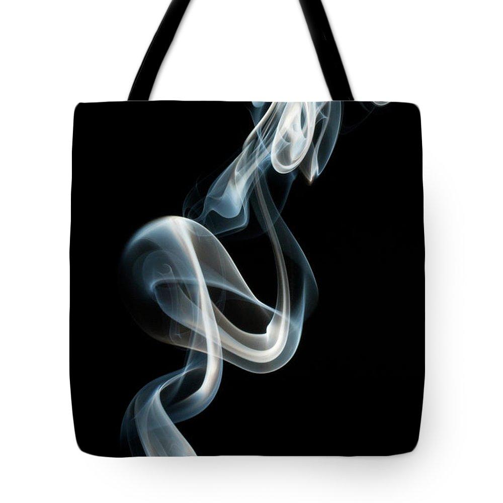 Black Background Tote Bag featuring the photograph Smoke by Vando Nascimento