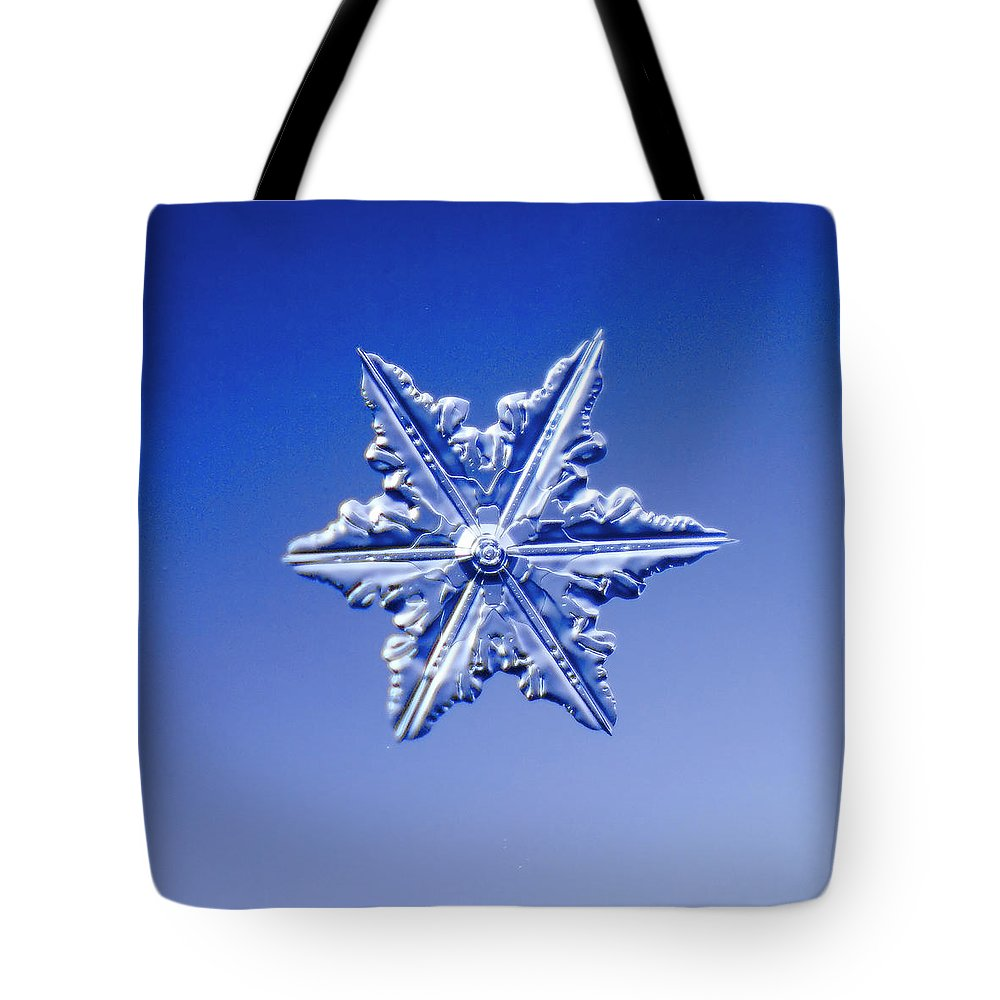 Snow Tote Bag featuring the photograph Snowflake On Blue Background by Fwwidall
