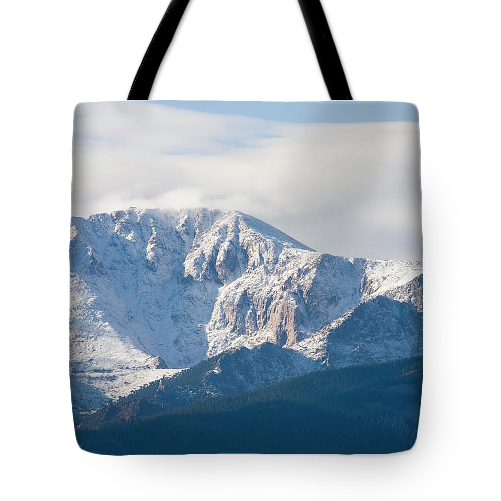 Extreme Terrain Tote Bag featuring the photograph Snowy Pikes Peak by Swkrullimaging