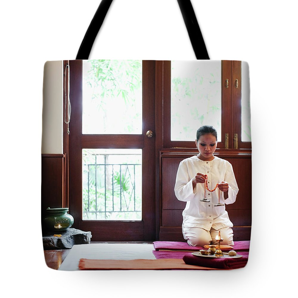 Spa Tote Bag featuring the photograph Spa Therapist Prepares Massage Room by Matthew Wakem
