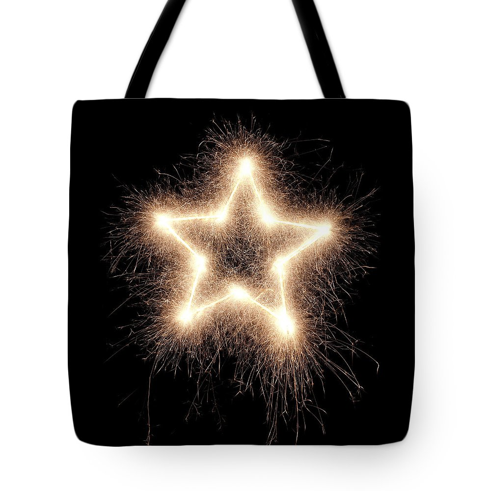 Holiday Tote Bag featuring the photograph Sparkling Star by Amriphoto