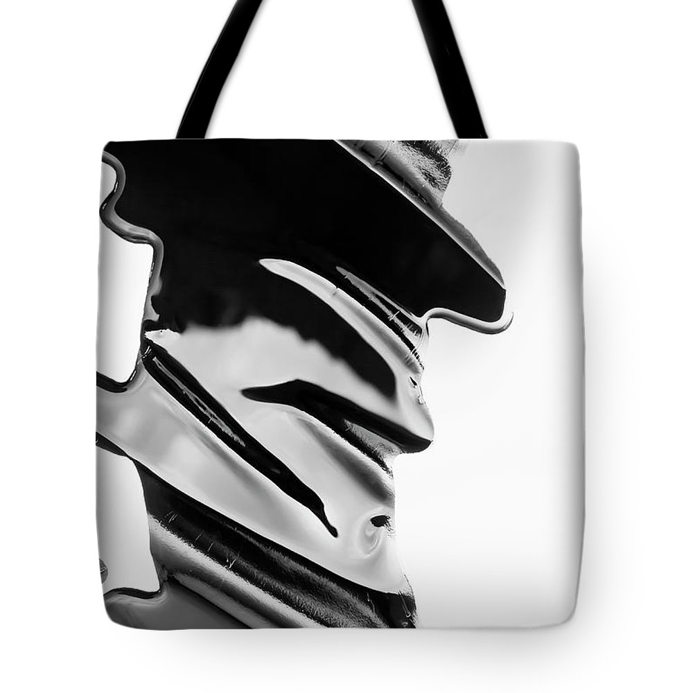 Problems Tote Bag featuring the photograph Spilled Black Paint Making An Abstract by Fstop Images - Ralf Hiemisch