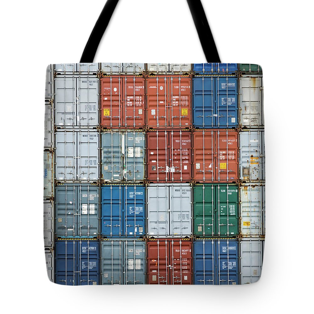Trading Tote Bag featuring the photograph Stack Of Cargo Containers Full Frame by Andy Andrews