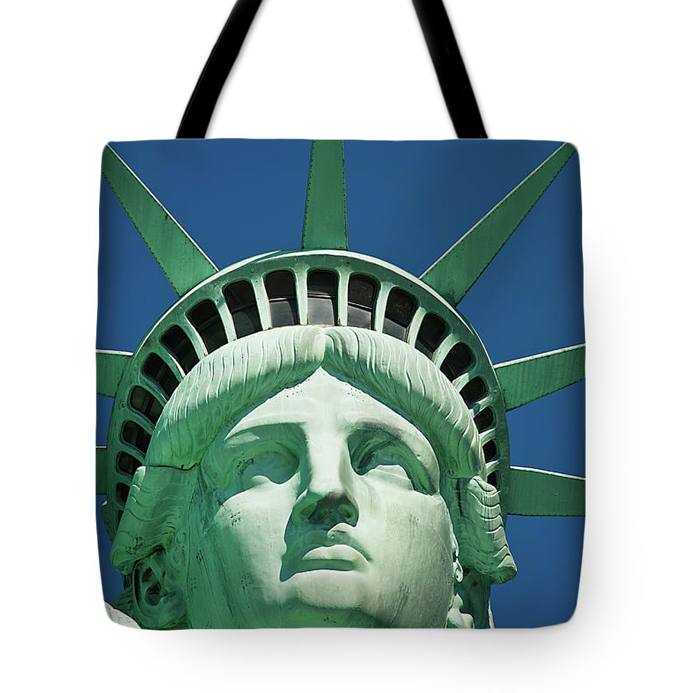Crown Tote Bag featuring the photograph Statue Of Liberty by Tetra Images