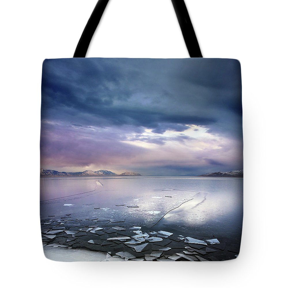 Scenics Tote Bag featuring the photograph Storm Clouds Clearing Over Icy Lake by Utah-based Photographer Ryan Houston