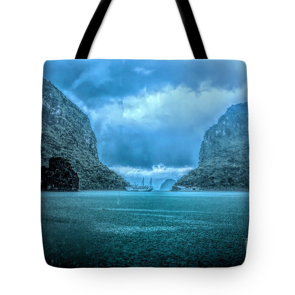 Vietnam Tote Bag featuring the photograph Storm Clouds Invade Ha Long Bay Blue Rain by Chuck Kuhn