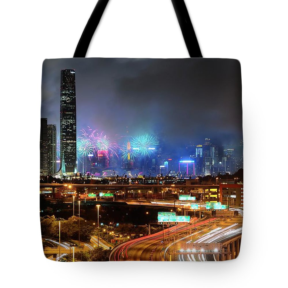 Firework Display Tote Bag featuring the photograph Street Light Crosses Firework by Eddymtl