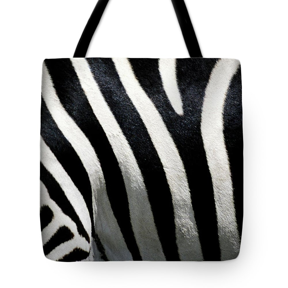 Black Color Tote Bag featuring the photograph Stripes On Zebra, Extreme Close-up by Medioimages/photodisc