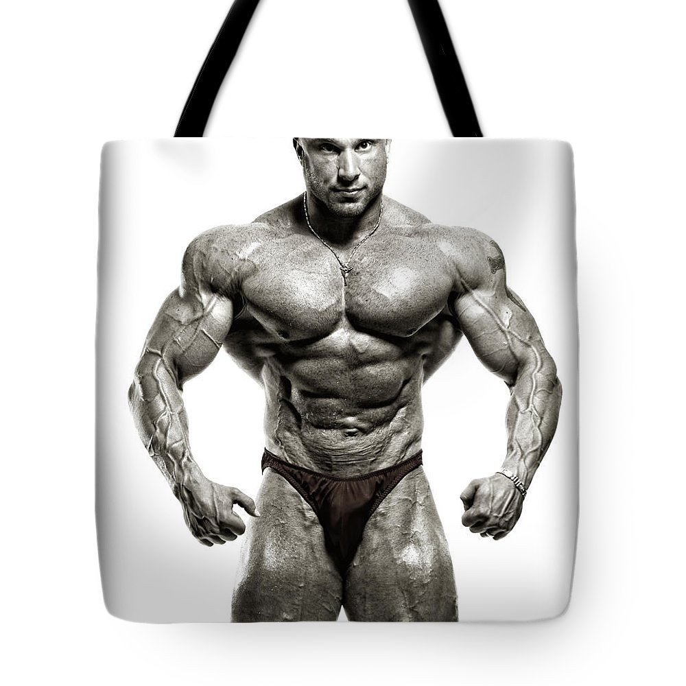 Abdominal Muscle Tote Bag featuring the photograph Strong Male Model by Spanic