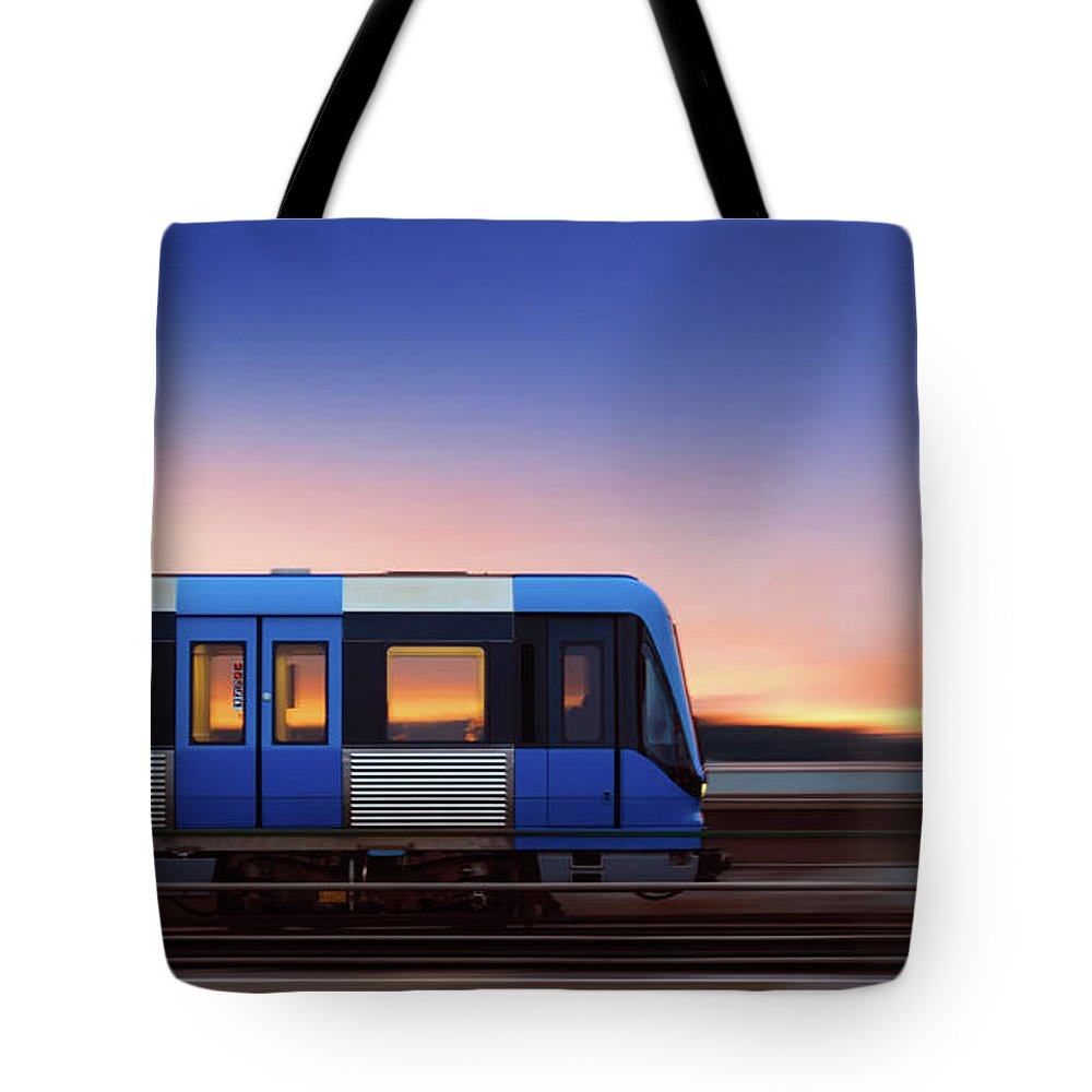 Train Tote Bag featuring the photograph Subway Train In Profile Crossing Bridge by Olaser