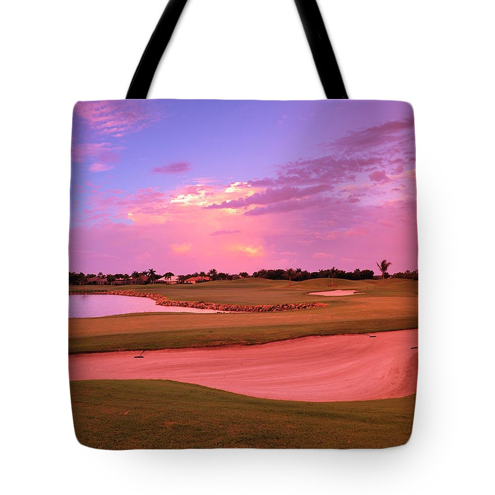 Sand Trap Tote Bag featuring the photograph Sunrise View Of A Resort On A Golf by Rhz
