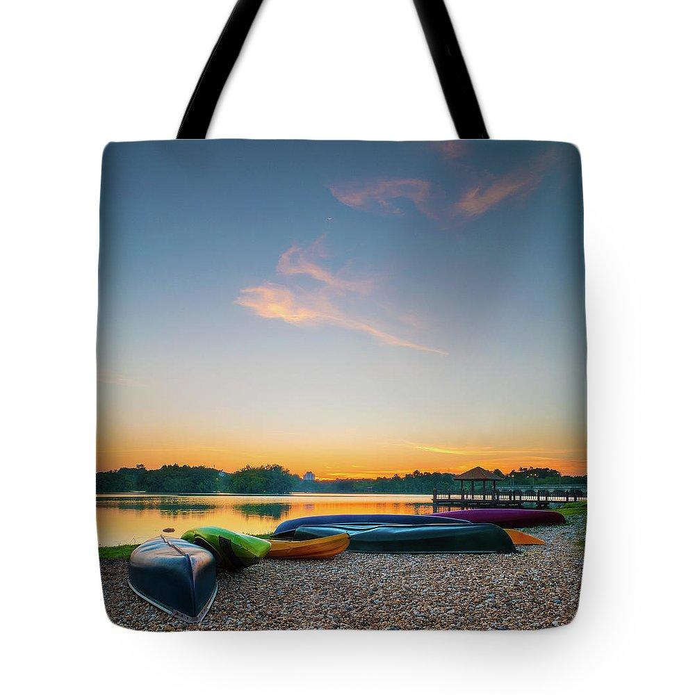 Tranquility Tote Bag featuring the photograph Sunset At Kayak Putrajaya Lake by Muhammad Hafiz Bin Muhamad